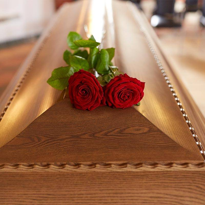 coffin with flowers on top